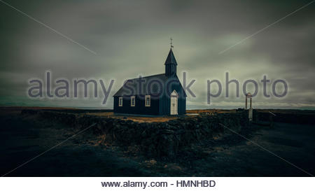 Black church in Helinar, Iceland - Stock Photo