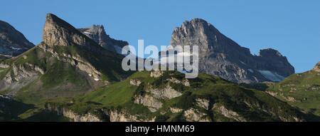 Green meadows, mountains and glacier in Engelberg, Switzerland. Summer scene on mount Titlis. - Stock Photo