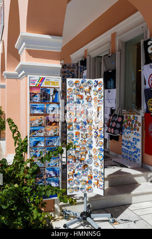 Fridge magnets, postcards and souvenirs at a shop in Oia, Santorini, a Mediterranean Greek Island in the Cyclades - Stock Photo