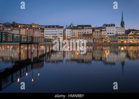 Row of houses of the old town of Zurich reflected on the Limmat River at night,Switzerland. - Stock Photo