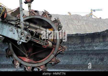 mining excavator machine in brown coal mine - Stock Photo