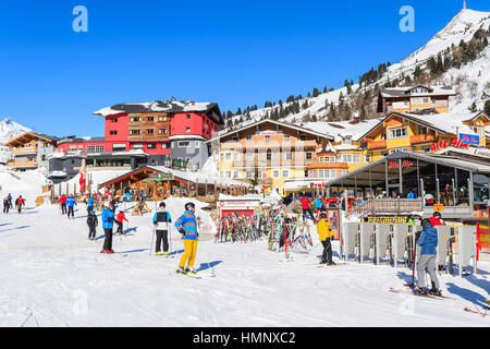 OBERTAUERN SKI RESORT, AUSTRIA - JAN 22, 2017: skiers on winter vacation in Obertauern ski area in Salzburg land, - Stock Photo