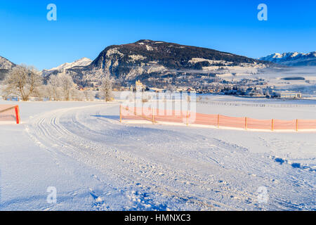 Ski track in Mauterndorf village on early winter morning, Salzburg Land, Austria - Stock Photo
