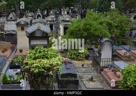 Quiet rules among the graves in the famous graveyard Le Cimetière du Père-Lachaise / Père Lachaise Cemetery in Paris, - Stock Photo