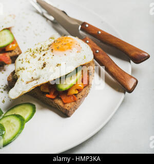 Breakfast toast with fried eggs, vegetables. square crop - Stock Photo