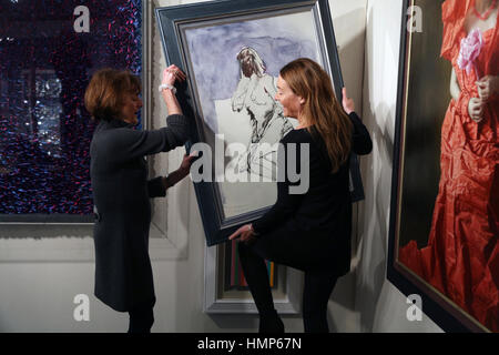 Limited edition of Tracy Emin work being hung at the Mayfair Antiques and Fine Art Fair at the Marriott Hotel in - Stock Photo