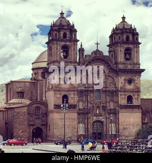 Front view at the La Compania de Jesus Church at Plaza de Armas in Cusco, Peru. - Stock Photo