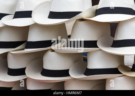handcrafted Panama hats in the market stand of a street vendor - Stock Photo