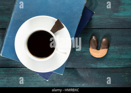 Strong coffee poured from vintage pot into cup - Stock Photo