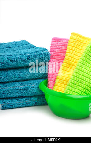 Stack of towels, bright napkins in the bowl isolated on white background - Stock Photo