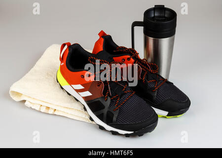 running shoes with towel and bottle - prepare to run in the nature, sport concept - Stock Photo