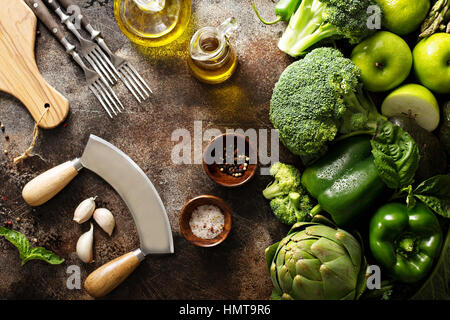 Variety of green vegetables and fruits copyspace on dark table - Stock Photo