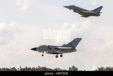 BERLIN / GERMANY - JUNE 3, 2016: german Panavia Tornado and a eurofighter typhoon lands on airport schoenefeld, - Stock Photo