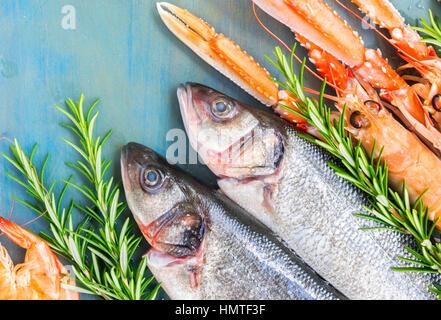 Fresh seafood on blue background - Stock Photo