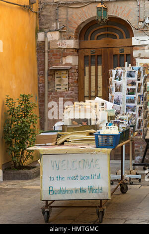 Welcome to the most beautiful bookshop in the world sign at Libreria Acqua Alta book shop at Venice, Italy in January - Stock Photo