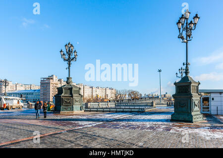 Moscow, Russia. 5th Feb, 2017. Unidentified people cross Patriarch's bridge over the Moscow river by the Cathedral - Stock Photo