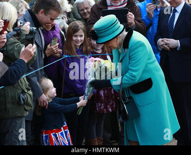 West Newton, UK. 05th Feb, 2017. HM Queen Elizabeth II does a little walk about and collects a bouquet of flowers - Stock Photo
