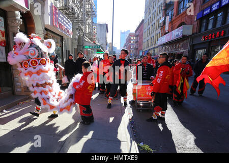 New York, USA. 4th Feb, 2017. A lion dance troupe performs in front of a store on Elizabeth St. - Stock Photo