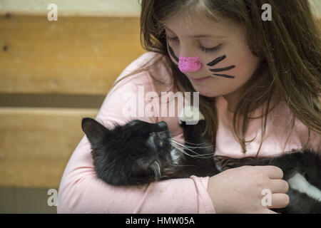 Wantagh, USA. 5th Feb, 2017. Ayla Shah, 6 1/2, of Merrick, is holding Salsa, a 5 month old female kitten available - Stock Photo