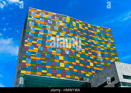 Modern building with colorful patchwork facade in the centre of Ulaanbaatar, Mongolia - Stock Photo