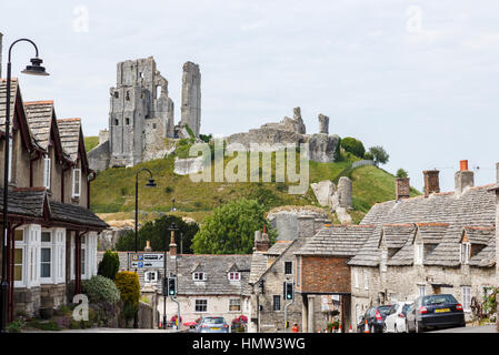 The hilltop ruins of Corfe Castle, survivor of the English Civil War, in the village of Corfe, Dorset, south-west - Stock Photo