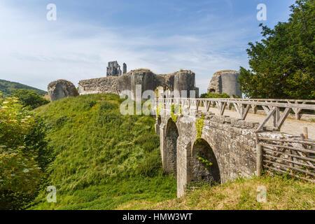 Entrance bridge leading to the hilltop ruins of Corfe Castle, survivor of the English Civil War, in Corfe, Dorset, - Stock Photo