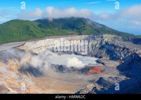 Caldera with crater lake, steam rising from Poas Volcano, Poas Volcano National Park, Costa Rica - Stock Photo