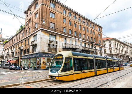 MILAN, ITALY - JUNE 14, 2016: Modern tram (Serie ATM 7500 'Sirietto') on the streets of Milan. Milan tramway network - Stock Photo