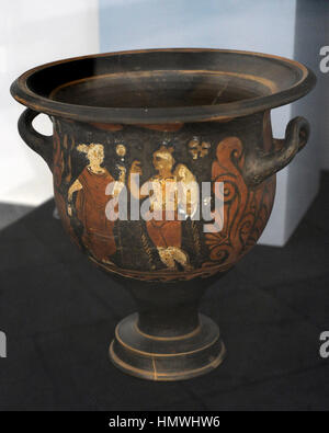 Campanian red figure krater depicting a warrior with helmet, shield, cuirass and spear looking a female figure with - Stock Photo