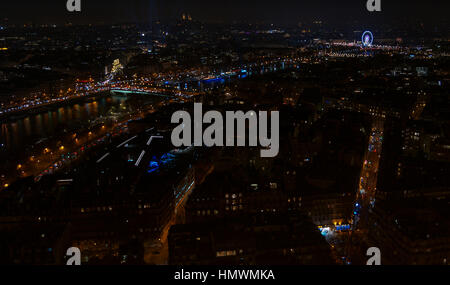 Aerial panoramic view of Paris city at night with principal attractions from Eiffel Tower - Stock Photo