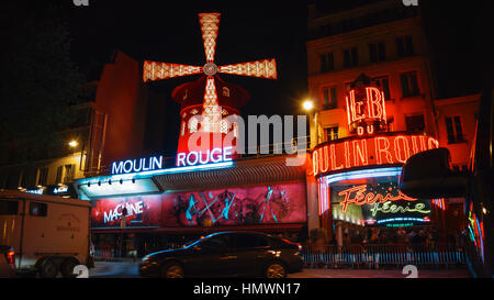 The Moulin Rouge windmill, Moulin Rouge is a famous cabaret built in 1889, located in the Paris red-light district - Stock Photo