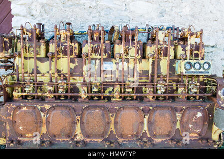 an old outdated diesel engine with gauges - Stock Photo