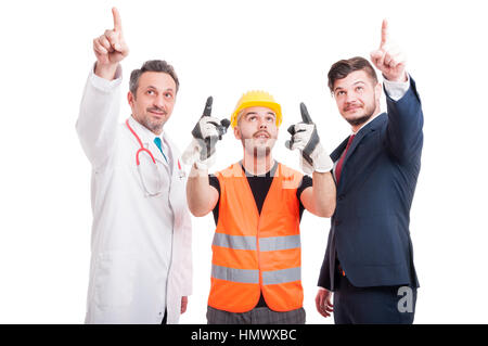Constructor, businessman, and doctor or medic pointing all fingers up and looking at something isolated on white - Stock Photo