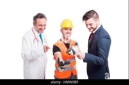 Cheerful group of businessman, doctor and engineer holding something and all pointing at his hand isolated on white - Stock Photo