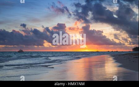 Colorful sunrise over Atlantic Ocean coast, Bavaro beach, Hispaniola Island. Dominican Republic, coastal landscape - Stock Photo