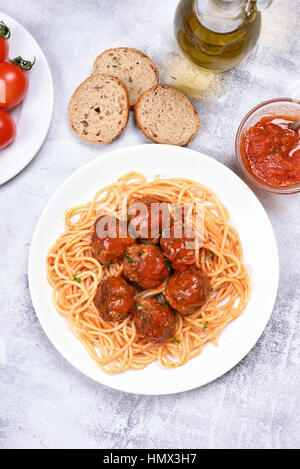 Meatballs in tomato sauce and spaghetti, top view - Stock Photo