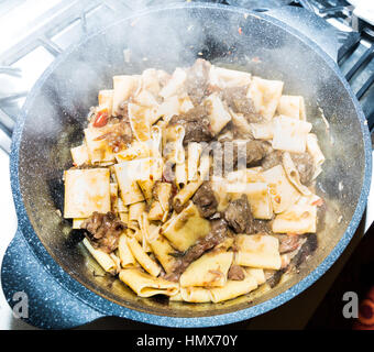 Pasta alla genovese, sauce composed by beef   and onions - Stock Photo
