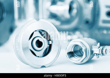 Check and ball valve with selective focus on thread fittings - Stock Photo