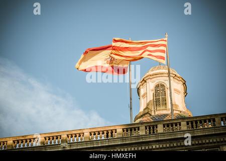 Barcelona, Catalonia, Spain. 6th Feb, 2017. The Spanish and the Catalan flag wave over the Palau de la Generalitat - Stock Photo