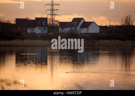 Dartford, Kent, UK. 7th February 2017. A stormy sunset near Dartford Kent. The sun is setting over a new housing - Stock Photo