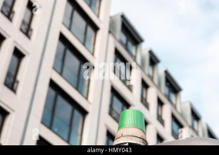 ESSEN, GERMANY - JANUARY 25, 2017: A green signal light in front of an office building at Rüttenscheider Straße - Stock Photo