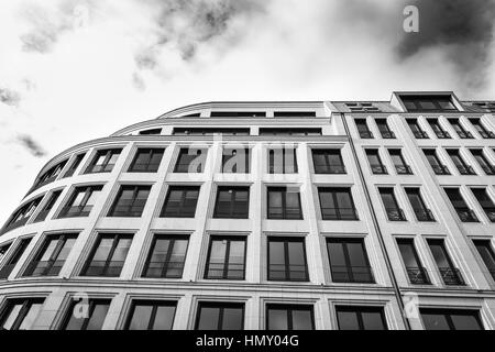 ESSEN, GERMANY - JANUARY 25, 2017: The facae of an office building at Rüttenscheider Straße contrasts with the vivid - Stock Photo