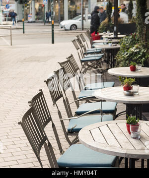 ESSEN, GERMANY - JANUARY 25, 2017: Despite of winter temperatures a cafe offers seats outdoors - Stock Photo