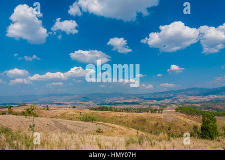 Beautiful summer sky and silhouettes of mountains on horizon - Stock Photo