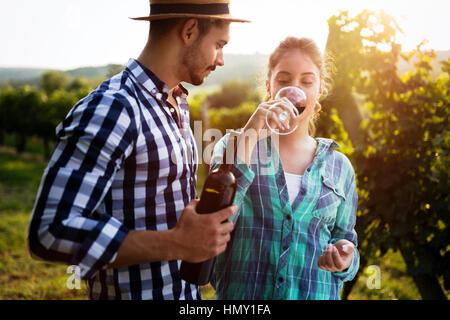 Romantic couple in vineyard before harvesting - Stock Photo