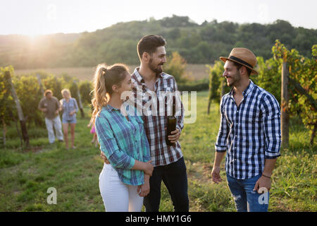 Wine grower and people in winery vineyard - Stock Photo