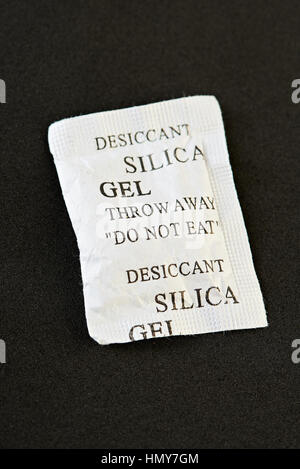 package of silica gel isolated on black background - Stock Photo