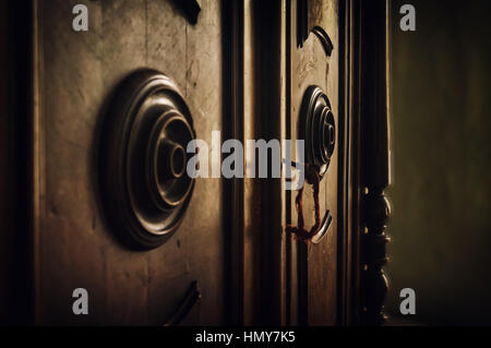 The key is in the door of the old vintage cabinet. - Stock Photo