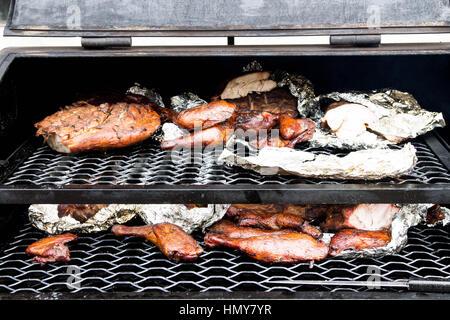 Cooking meat in the oven. Cooking meat in the oven. Preparation of meat on the BBQ. Preparation of meat in foil. - Stock Photo