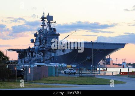 USS Iwo Jima (LHD-7) at sunset in the ship basin at NS Mayport - Stock Photo